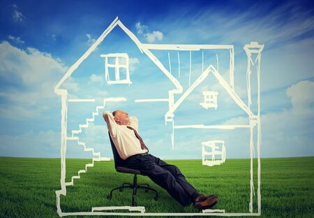 grass  plan: A safe house. Happy senior man enjoying his day in a new home Stock Photo