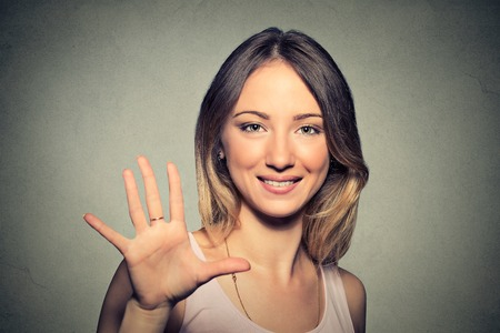 stop: Smiling woman making high five with her hand