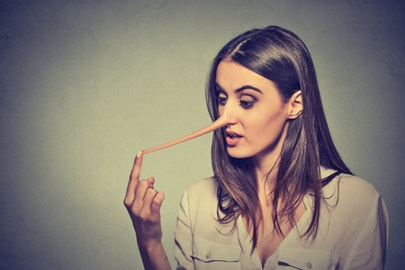 long nose: Woman with long nose isolated on grey wall background. Liar concept. Human face expressions, emotions, feelings.