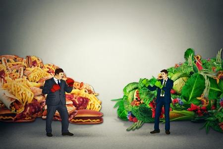 comida chatarra: Representante Comida vegetariana luchando chico alimentos grasos chatarra poco saludable con guantes de boxeo listos para golpear entre sí. Dieta batalla concepto de nutrición idea