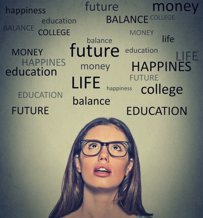 business education: Headshot of a young woman planning future life looking up Stock Photo