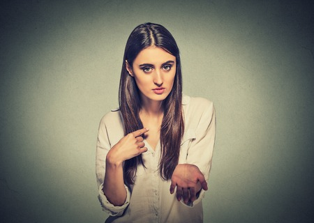 bitchy: Young woman asking for more money Stock Photo
