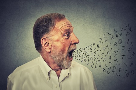 Man talking with alphabet letters coming out of his mouth. Communication, information, intelligence concept Standard-Bild