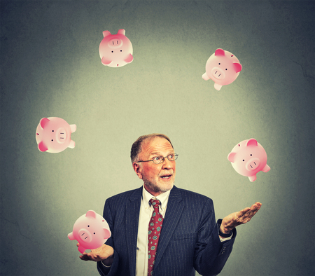 mutual fund: Mature happy business man juggling money