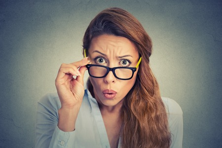 doubts: Surprised frustrated young woman Stock Photo