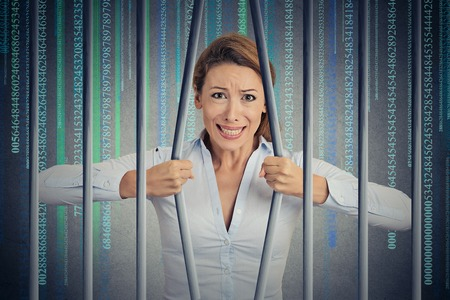 barrier free: Stressed desperate angry businesswoman bending bars of her digital prison binary code cell. Life limitations, law violation infringement internet addiction consequences concept. Face expression Stock Photo