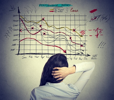 Woman analyst solving bad economy problem. Stressful business life concept Standard-Bild