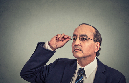 hair loss: man with glasses looking up