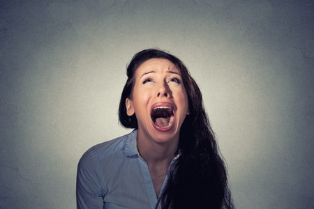 Woman screaming looking up Stock Photo