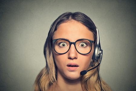 hands free phones: Funny looking shocked customer service representative. Human emotions feelings reaction
