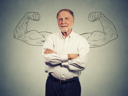 Portrait of a strong Old Man isolated on gray wall background