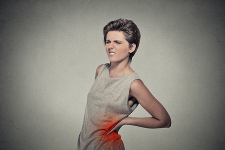 infections: young woman with backache back pain back colored in red isolated on gray background