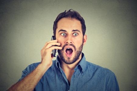 shocked: Shocked man talking on mobile phone