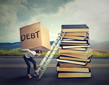 Student loan debt concept. Young woman with heavy box full of debt carrying it up the education ladder