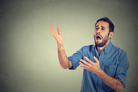 despaired: Desperate man screaming asking for help forgiveness Stock Photo