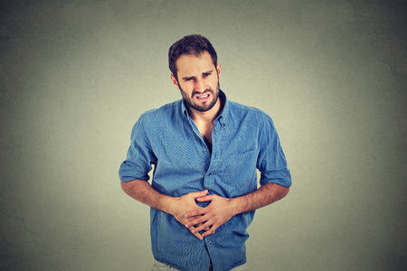 bowel: Young man with stomach pain indigestion