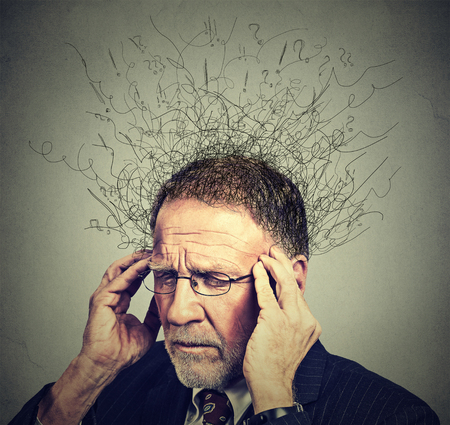 Closeup sad senior elderly man with worried stressed face expression looking down with brain melting into lines question marks. Obsessive compulsive, adhd, anxiety disorders concept
