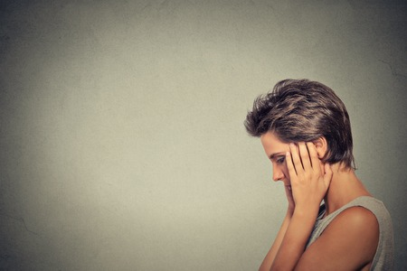 headache pain: problems. Sad woman Stock Photo