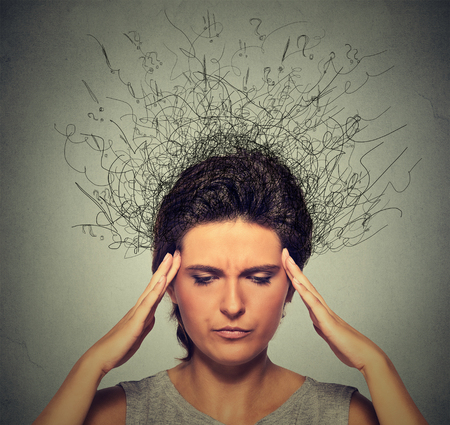 distraction: Closeup upset young woman with worried stressed face expression frowning and brain melting into lines question marks. Obsessive compulsive, adhd, anxiety, ocd disorders Stock Photo