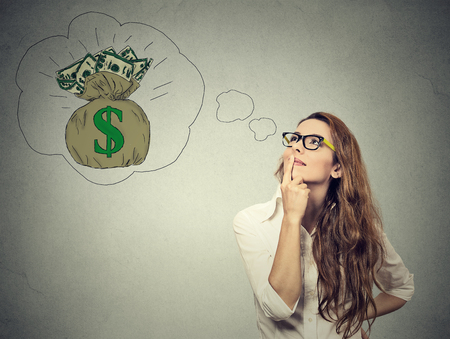 Woman dreaming of financial success Imagens
