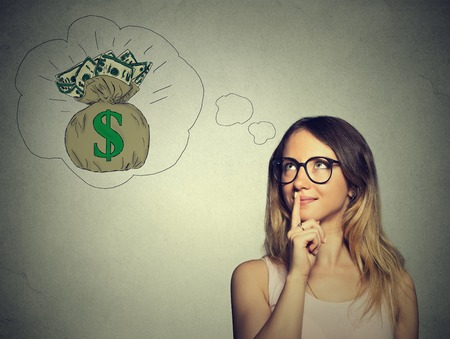 win: Woman dreaming of financial success Stock Photo