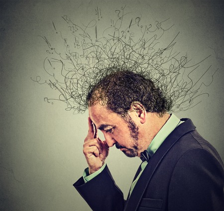 ocd: Closeup side profile worried middle aged man with worried stressed face expression and brain melting into lines question marks. Obsessive compulsive, adhd, anxiety disorders. Gray background Stock Photo