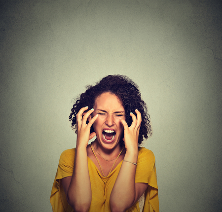 woman isolated: Very angry hysterical woman