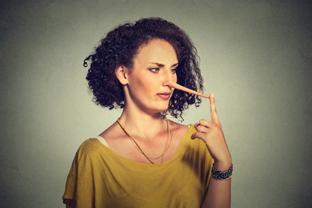 feelings and emotions: Woman with long nose isolated on grey wall background. Liar concept. Human face expressions, emotions, feelings.