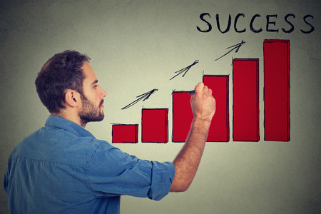 future earnings: Man drawing future successful earnings result chart Stock Photo