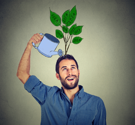 flower head: Self investment. Young man with many ideas Stock Photo