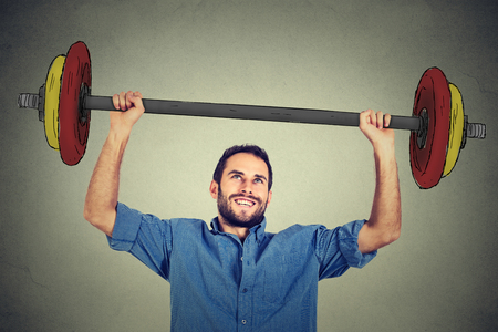 determinism: strong business man lifting barbell above head with two hands