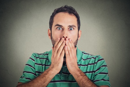 scared: Scared stunned shocked young man Stock Photo