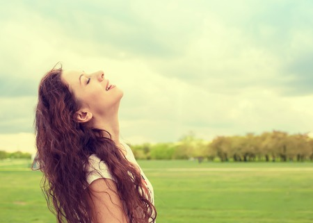 breath: Side profile woman smiling looking up to blue sky celebrating enjoying freedom. Positive human emotion face expression feeling life perception success, peace of mind concept. Free happy girl