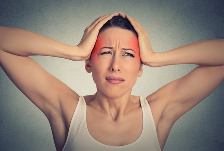 head ache: Closeup portrait beautiful woman suffering from head ache isolated on gray wall background