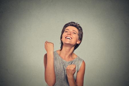 jubilate: Success. Happy woman exults pumping fists ecstatic celebrates success