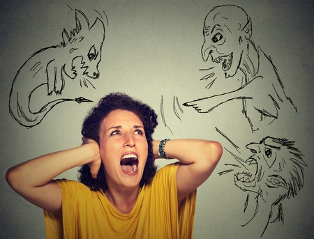 judged: Bad evil men pointing at stressed woman. Desperate scared young woman isolated on grey office wall background. Negative human emotions face expression feelings life perception