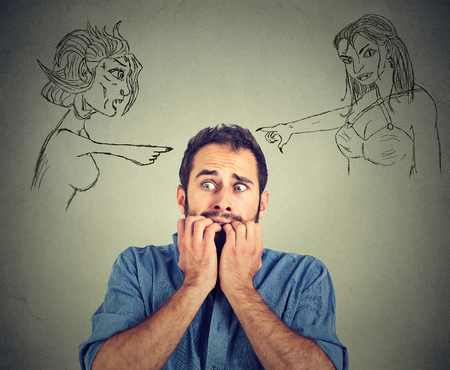 phobia: Bad evil women pointing at stressed anxious young man. Negative human emotions face expression feelings life perception. Relationship difficulties concept. Insecure weak funny looking guy