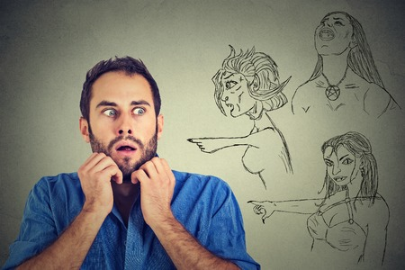 point of demand: Bad evil women pointing at stressed anxious young man. Negative human emotions face expression feelings life perception. Relationship difficulties concept. Insecure weak funny looking guy