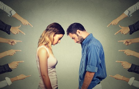 Marriage relationship difficulties concept. Accusation of guilty people. Side profile sad upset woman and men looking down many fingers pointing at their back. Negative emotions feelings 스톡 콘텐츠
