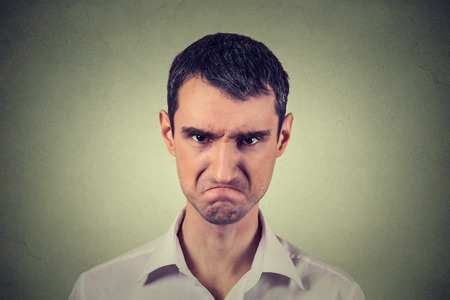 face to face: Closeup portrait of angry young man about to have nervous atomic breakdown isolated on gray background. Negative human emotions facial expression feelings attitude Stock Photo