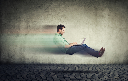 Fast internet concept. Autonomous self driving vehicle car technology. Levitating business man on road using laptop
