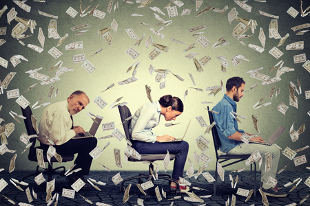 Company employees men young woman sitting on chair working on laptops making money under dollar banknotes rain. Successful internet business concept