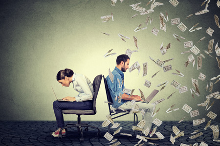 e money: Employee compensation economy concept. Woman working on laptop sitting next to young  man under money rain. Pay difference concept.