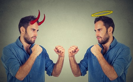 Side profile man good fighting evil Stock Photo