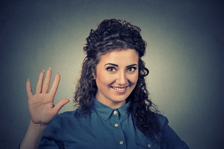 give hand: Smiling woman making high five with her hand