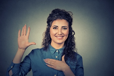 sign language: Young woman making a promise