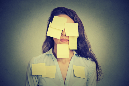 Woman covered in yellow notes Stock Photo