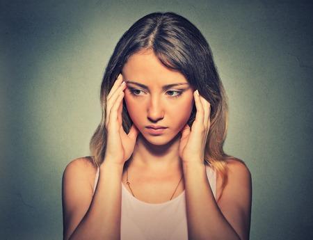 negative emotion: Portrait of a sad woman on gray background. Negative emotion facial expression feeling reaction
