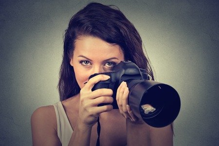 take a: young woman taking pictures with professional dslr camera