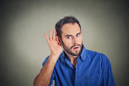 secretly: Portrait of handsome man secretly listening on private conversation. Human face, expression, emotion, body language. Stock Photo